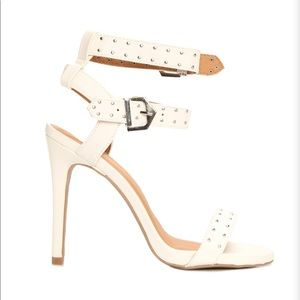 White strappy heeled sandals